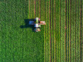 Tractor mowing green field Royalty Free Stock Photo