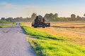 Tractor reaping wheat Royalty Free Stock Photo
