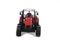 Tractor red toy on white background Royalty Free Stock Photo