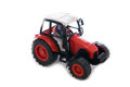 Tractor red toy on white background Royalty Free Stock Image