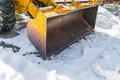 Tractor with snow plow in winter. Royalty Free Stock Photo