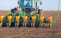 Tractor sowing field agricultural and cultivating Royalty Free Stock Photos