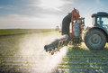 Tractor spraying pesticides on soy bean Royalty Free Stock Images