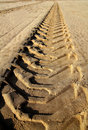 Tractor tires footprint on beach sand Royalty Free Stock Photo