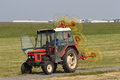 Tractor to mow grass on field Stock Photo