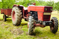 Tractor and trailer old red in an orchard Royalty Free Stock Photos