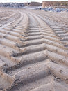 Tractor tyre tracks on the beach Royalty Free Stock Photo