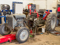 Tractor under repair a farm partially disassembled undergoing repairs in a workshop Stock Images