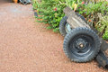 Tractor wheels spare parts on dirt way in front of home Royalty Free Stock Photo