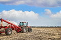 Tractor working in field Royalty Free Stock Photo