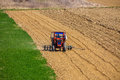 Tractor working in a field Royalty Free Stock Photo