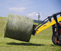 Tractor working with a Hay Bale Royalty Free Stock Photo
