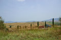 Tractor working in tuscany italy landscape of the countryside Stock Photos