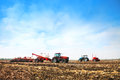 Tractors with tanks in the field. Agricultural machinery and farming. Royalty Free Stock Photo