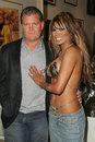 Tracy bingham traci bingham and her fiance john at champagne and bikinis hosted by geoff thomas designs and featuring his metallic Stock Photography
