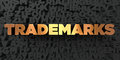 Trademarks - Gold text on black background - 3D rendered royalty free stock picture