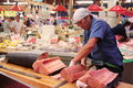 Trader cutting and filetting swordfish meat in Omi-cho market Kanazawa Japan Royalty Free Stock Photo