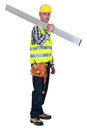Tradesman carrying a girder metal Stock Image