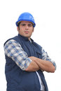 Tradesman with his arms crossed portrait of a standoffish Stock Image