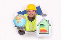 Tradesman holding a globe and an energy efficiency rating chart Stock Photography