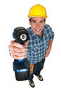 Tradesman holding a power tool in the air Royalty Free Stock Images