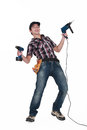Tradesman holding power tools a his Stock Photo