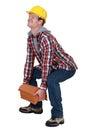 Tradesman lifting a heavy load Royalty Free Stock Photo
