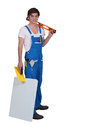 Tradesman posing with his tools young and materials Royalty Free Stock Photos