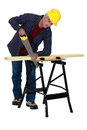 Tradesman sawing a plank Royalty Free Stock Photo