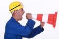 Tradesman screaming into a pylon Royalty Free Stock Photo