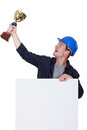 Tradesman with a trophy holding up Stock Photos