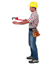 Tradesman using a pipe wrench to help drag and place an object Royalty Free Stock Photos