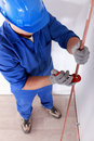 Tradesman using a tool Royalty Free Stock Photo