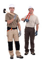 Tradesmen holding their tools Royalty Free Stock Photo