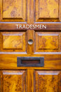 Tradesmen's entrance door Royalty Free Stock Photo