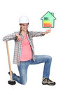 Tradeswoman holding up rating chart Royalty Free Stock Images