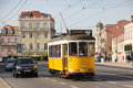 Tradidional yellow tram in belem street lisbon portugal a surrounded by old historical buildings alfonso de albuquerque square Stock Photo