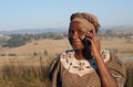 Traditional african zulu woman speaking on mobile phone cell telephone in rural kwazulu natal Stock Photography