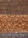 Traditional alpine wooden shingle wall in the sun Royalty Free Stock Images