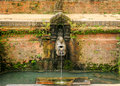 Traditional ancient water tap of nepal a style stone o f with running in bhaktapur Stock Image