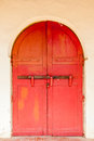 Traditional antique red wooden door double lock by padlock and w Royalty Free Stock Photo