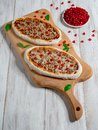 Traditional Arabic pizza manaqish with meat and pomegranate. Royalty Free Stock Photo