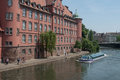 Traditional architecture and tourist boat on Rhine river at little France quarter in Strasbourg Royalty Free Stock Photo