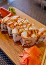 Traditional Asian food sushi on wooden plate.