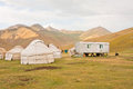 Traditional asian tents Yurts - homes of the local nomads in a Tian Shan mountains Royalty Free Stock Photo