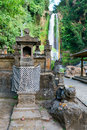 Traditional balinese house spirits sacred waterfall gingit background Royalty Free Stock Images