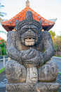 Traditional balinese sculpture on the temple entrance Stock Photo