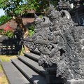 Traditional Balinese stone dragon image in the temple Royalty Free Stock Photo