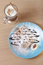 Traditional belgium soft fresh waffles with a decor on a plate a and cup of coffee whipped creams Stock Photos