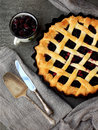 Traditional berries yeast pie tart on rustic wooden background. Homemade sweet cake. Baked pastry food. Top view. Space for text
